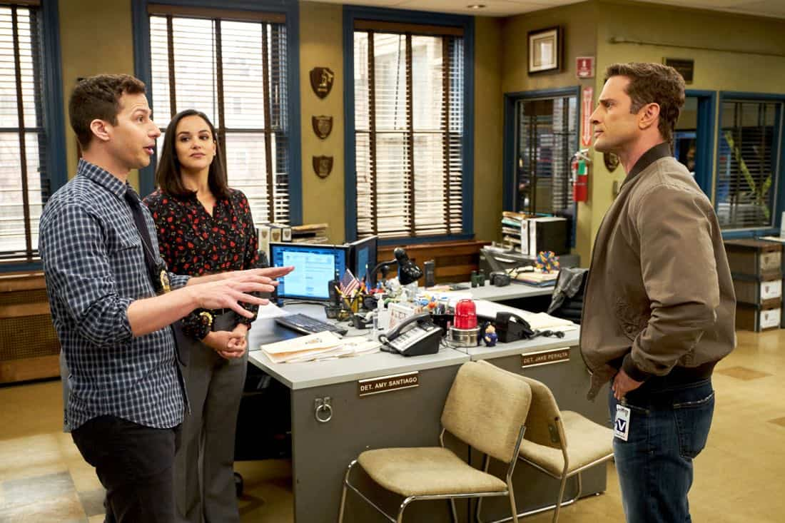 "BROOKLYN NINE-NINE: L-R: Andy Samberg, Melissa Fumero and guest star XXX in the ""The Puzzle Master"" episode of BROOKLYN NINE-NINE airing Sunday, April 8 (8:30-9:00 PM ET/PT) on FOX. CR: FOX"