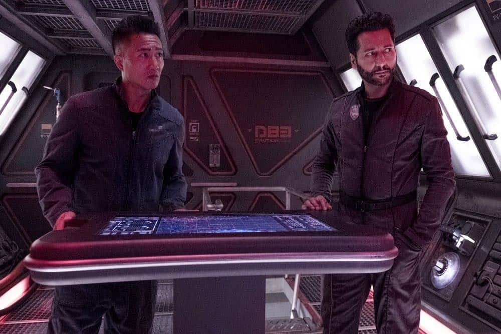 """THE EXPANSE -- """"Fight or Flight"""" Episode 301 -- Pictured: (l-r) Terry Chen as Prax, Cas Anvar as Alex Kamal -- (Photo by: Rafy/Syfy)"""