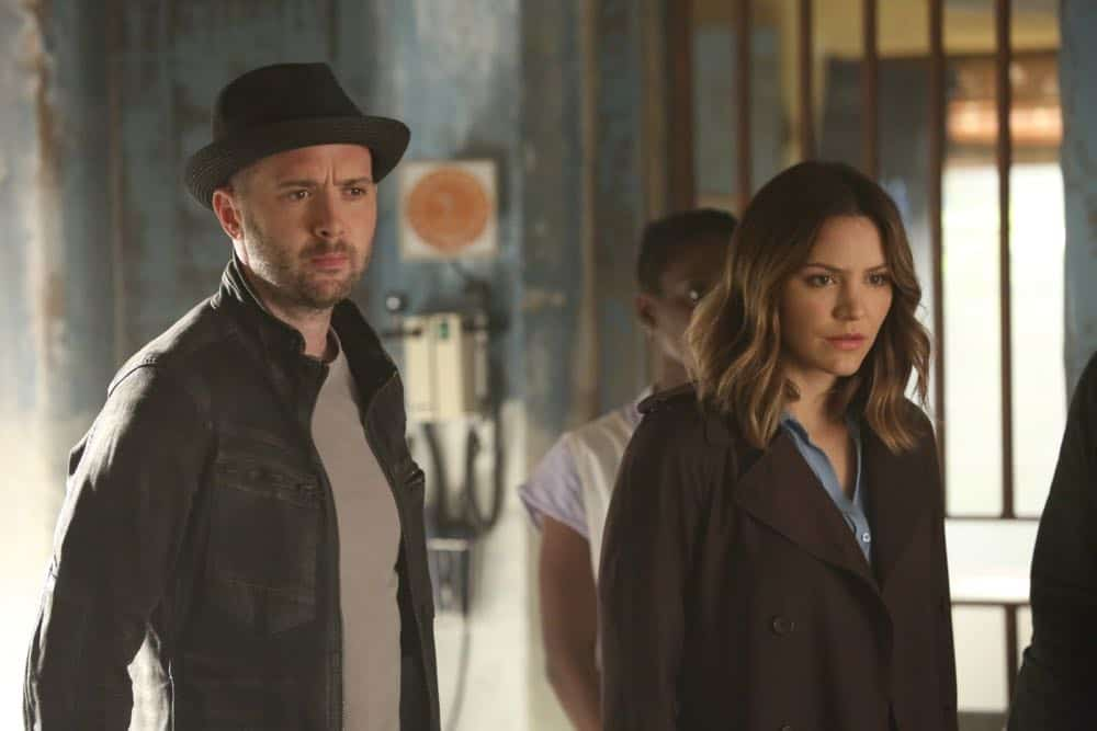 """""""A Lie in the Sand"""" -- Team Scorpion heads to Northeast Africa where they must carefully navigate a minefield in order to save the lives of local villagers. Also, Paige and Walter's relationship takes a shocking turn, and Toby and Happy make an important decision, on the fourth season finale of SCORPION, Monday, April 16 (10:00-11:00 PM, ET/PT) on the CBS Television Network. Pictured: Eddie Kaye Thomas, Katharine McPhee   Photo: Michael Yarish/CBS ©2018 CBS Broadcasting, Inc. All Rights Reserved"""