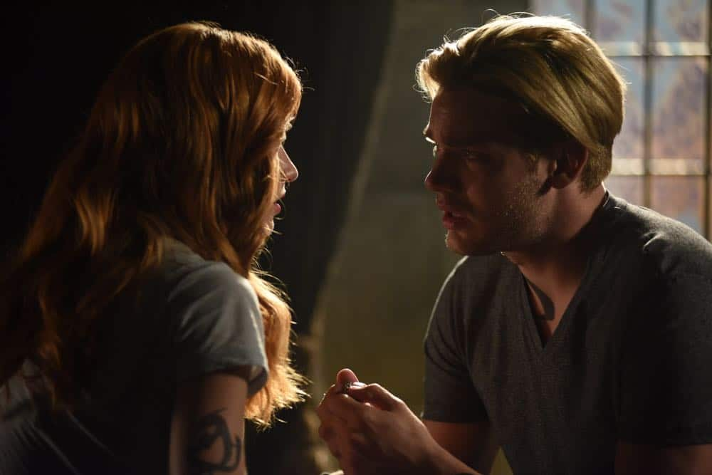 """SHADOWHUNTERS - """"Thy Soul Instructed"""" - Jace's concerns grow about his mental state and turns to Luke for information on his family's past. Clary and Izzy go after a rogue vampire and Simon hunts for a new apartment. This episode of """"Shadowhunters"""" airs Tuesday, April 10 (8:00 - 9:00 p.m. EDT) on Freeform. (Freeform/John Medland) KATHERINE MCNAMARA, DOMINIC SHERWOOD"""