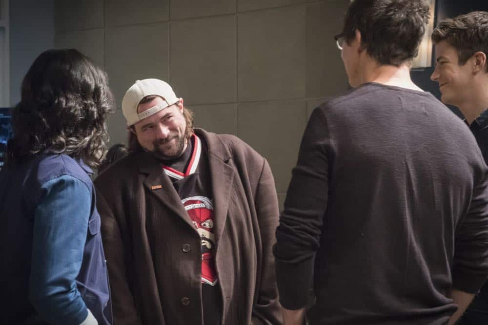 """The Flash -- """"Null and Annoyed"""" -- Image Number: FLA417a_BTS_0395.jpg -- Pictured (L-R): Behind the scenes with Kevin Smith, Tom Cavanagh and Grant Gustin -- Photo: Katie Yu/The CW -- © 2018 The CW Network, LLC. All rights reserved"""
