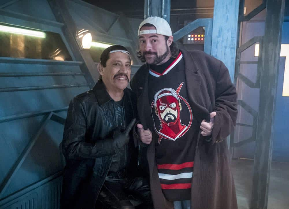 """The Flash -- """"Null and Annoyed"""" -- Image Number: FLA417a_BTS_0356b.jpg -- Pictured (L-R): Behind the scenes with Kevin Smith and Danny Trejo -- Photo: Katie Yu/The CW -- © 2018 The CW Network, LLC. All rights reserved"""