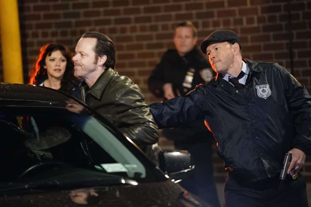 """Risk Management"" -- Danny and Baez race to find a missing girl who will die within 72 hours without her heart medication. Also, Jamie and Eddie are on the wrong side of an investigation after engaging in a car chase, Frank, Garrett and Gormley investigate the rise in the settlement of lawsuits against cops, and Sean wins an essay contest and receives a medal from former New York City Mayor David Dinkins, on BLUE BLOODS, Friday, April 13 (10:00-11:00 PM, ET/PT) on the CBS Television Network. Pictured: Marisa Ramirez, Donnie Wahlberg. Photo: John Paul Filo/CBS ©2018CBS Broadcasting Inc. All Rights Reserved."