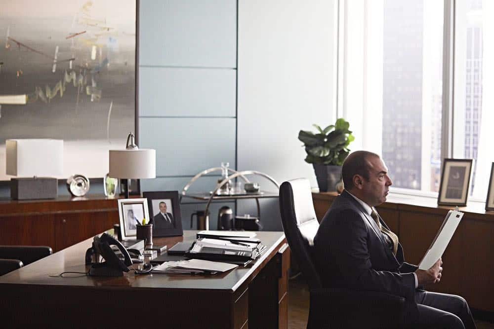 "SUITS -- ""Pulling the Goalie"" Episode 714 -- Pictured: Rick Hoffman as Louis Litt -- (Photo by: Shane Mahood/USA Network)"