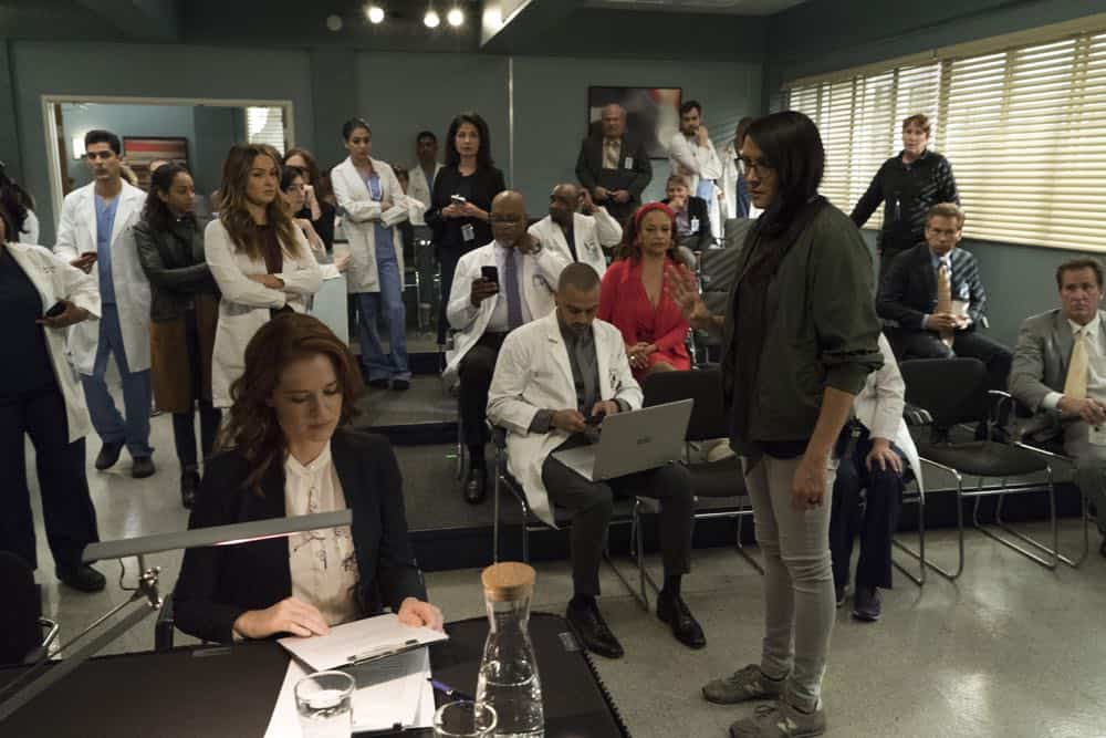 "GREY'S ANATOMY - ""Judgment Day"" - During presentations on Grey Sloan Surgical Innovation Prototypes Day, Arizona shares some cookies from an appreciative patient that, unbeknownst to her, contain a special ingredient. Meanwhile, Catherine reveals some shocking details to Jackson about his grandfather's past; and Jo steps in mid-operation on a major surgery after Bailey and Meredith are down for the count, on ""Grey's Anatomy,"" THURSDAY, APRIL 19 (8:00-9:00 p.m. EDT), on The ABC Television Network. (ABC/Byron Cohen) RUSHI KOTA, CAMILLA LUDDINGTON, SARAH DREW, JIM PICKENS, JESSE WILLIAMS, DEBBIE ALLEN, SYDNEY FREELAND (DIRECTOR)"