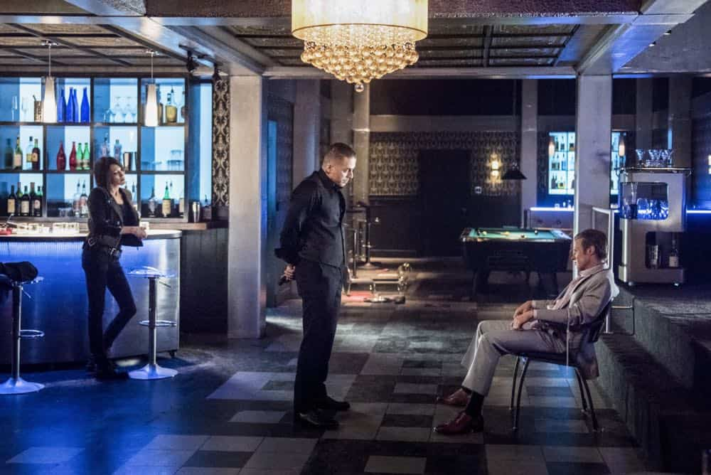 """Arrow -- """"The Dragon"""" -- Image Number: AR619a_0272.jpg -- Pictured (L-R): Katie Cassidy as Laurel/Black Siren, Kirk Acevedo as Ricardo Diaz and Ashton Holmes as Eric Cartier -- Photo: Dean Buscher/The CW -- © 2018 The CW Network, LLC. All rights reserved."""