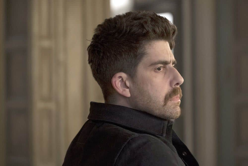 "TAKEN -- ""Imperium"" Episode 212 -- Pictured: Adam Goldberg as Kilroy -- (Photo by: Christos Kalohoridis/NBC)"