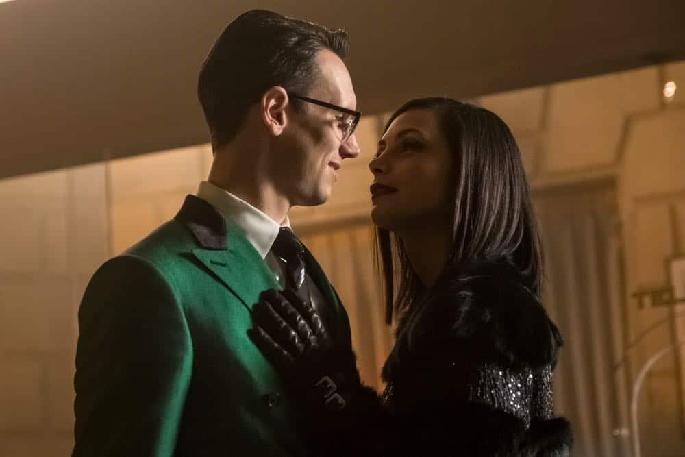 "GOTHAM: L-R: Cory Michael Smith and Morena Baccarin in the ""A Dark Knight: To Our Deaths and Beyond"" episode of GOTHAM airing Thursday, April 19 (8:00-9:00 PM ET/PT) on FOX. ©2018 Fox Broadcasting Co. Cr: FOX"
