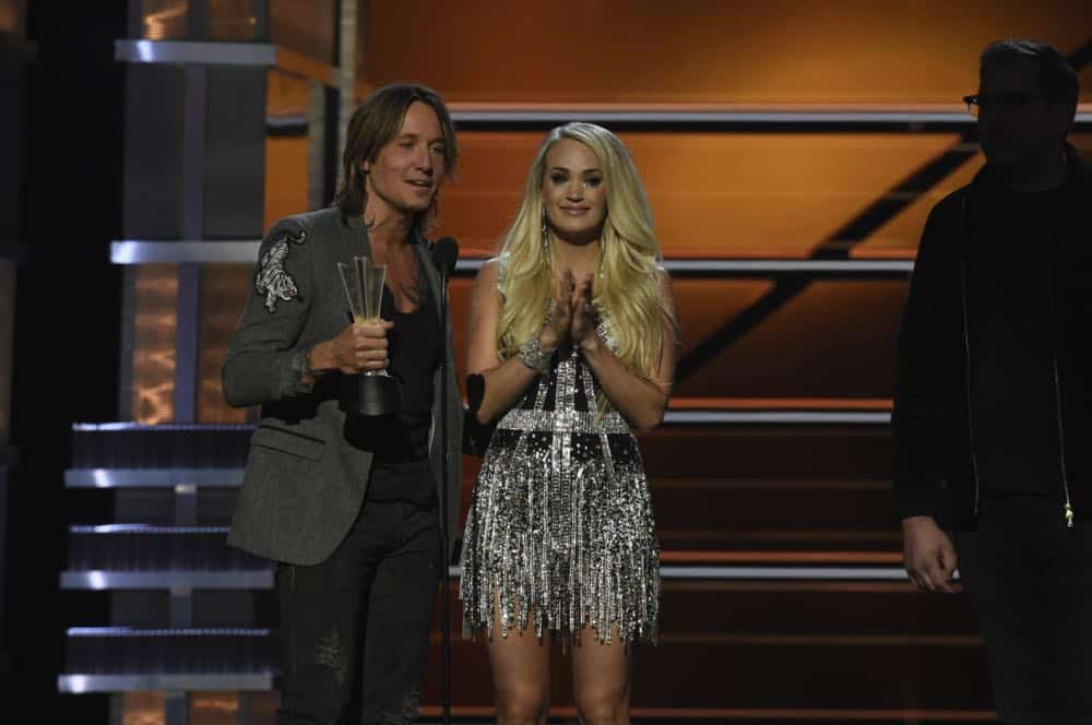 Keith Urban and Carrie Underwood accept the award for Vocal Event of the Year at the 53RD ACADEMY OF COUNTRY MUSIC AWARDS, live from the MGM Grand Garden Arena in Las Vegas Sunday, April 15, 2018 at 8:00 PM ET/PT on CBS.  Photo: Michele Crowe/CBS ©2018 CBS Broadcasting, Inc. All Rights Reserved
