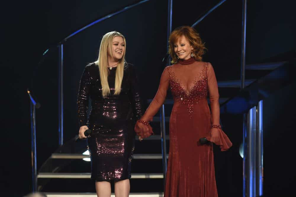 Reba McEntire and Kelly Clarkson perform at the 53RD ACADEMY OF COUNTRY MUSIC AWARDS, live from the MGM Grand Garden Arena in Las Vegas Sunday, April 15, 2018 at 8:00 PM ET/PT on CBS.  Photo: Michele Crowe/CBS ©2018 CBS Broadcasting, Inc. All Rights Reserved