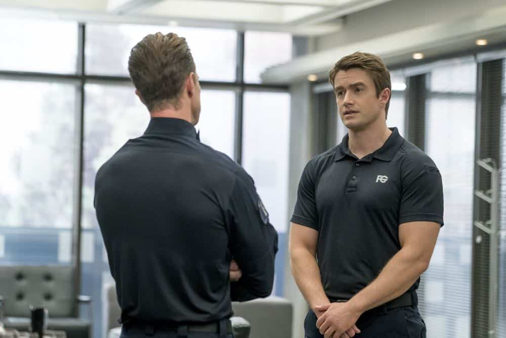 "iZombie -- ""Don't Hate the Player, Hate the Brain"" -- Image Number: ZMB407a_0027b.jpg -- Pictured (L-R): Jason Dohring as Chase Graves and Robert Buckley as Major -- Photo Credit: Katie Yu/The CW -- © 2018 The CW Network, LLC. All Rights Reserved"