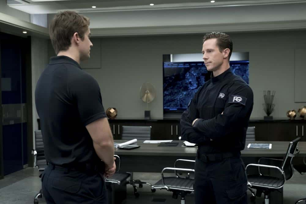 "iZombie -- ""Don't Hate the Player, Hate the Brain"" -- Image Number: ZMB407a_0109b.jpg -- Pictured (L-R): Robert Buckley as Major and Jason Dohring as Chase Graves -- Photo Credit: Katie Yu/The CW -- © 2018 The CW Network, LLC. All Rights Reserved"