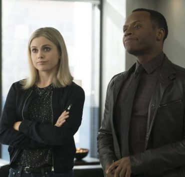 """iZombie -- """"Don't Hate the Player, Hate the Brain"""" -- Image Number: ZMB407a_0284b.jpg -- Pictured (L-R): Rose McIver as Liv and Malcolm Goodwin as Clive -- Photo Credit: Katie Yu/The CW -- © 2018 The CW Network, LLC. All Rights Reserved"""