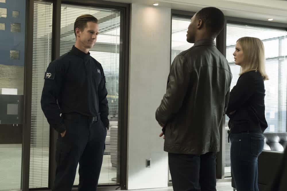 "iZombie -- ""Don't Hate the Player, Hate the Brain"" -- Image Number: ZMB407a_0308b.jpg -- Pictured (L-R): Jason Dohring as Chase Graves, Malcolm Goodwin as Clive, and Rose McIver as Liv-- Photo Credit: Katie Yu/The CW -- © 2018 The CW Network, LLC. All Rights Reserved"