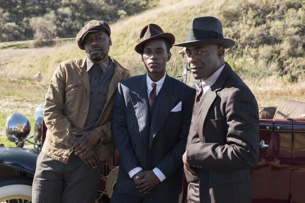 "TIMELESS -- ""King of Delta Blues"" Episode 206 -- Pictured: (l-r) Malcolm Barrett as Rufus Carlin, Kamal Naiqui as Robert Johnson, Paterson Joseph as Connor Mason -- (Photo by: Justin Lubin/NBC)"