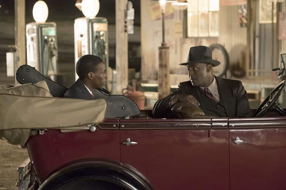 "TIMELESS -- ""King of Delta Blues"" Episode 206 -- Pictured: (l-r) Kamal Naiqui as Robert Johnson, Paterson Joseph as Connor Mason -- (Photo by: Justin Lubin/NBC)"