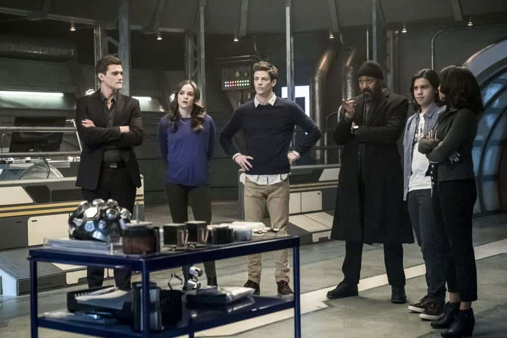 "The Flash -- ""Lose Yourself"" -- Image Number: FLA418a_0086b.jpg -- Pictured (L-R): Hartley Sawyer as Dibney, Danielle Panabaker as Caitlin Snow, Grant Gustin as Barry Allen, Jesse L. Martin as Detective Joe West, Carlos Valdes as Cisco Ramon and Candice Patton as Iris West -- Photo: Katie Yu/The CW -- © 2018 The CW Network, LLC. All rights reserved"