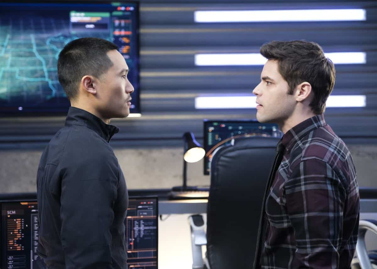"""Supergirl -- """"In Search of Lost Time"""" -- Image Number: SPG315a_0290.jpg -- Pictured (L-R): Curtis Lum as Agent Demos and Jeremy Jordan as Winn -- Photo: Robert Falconer/The CW -- © 2018 The CW Network, LLC. All Rights Reserved."""