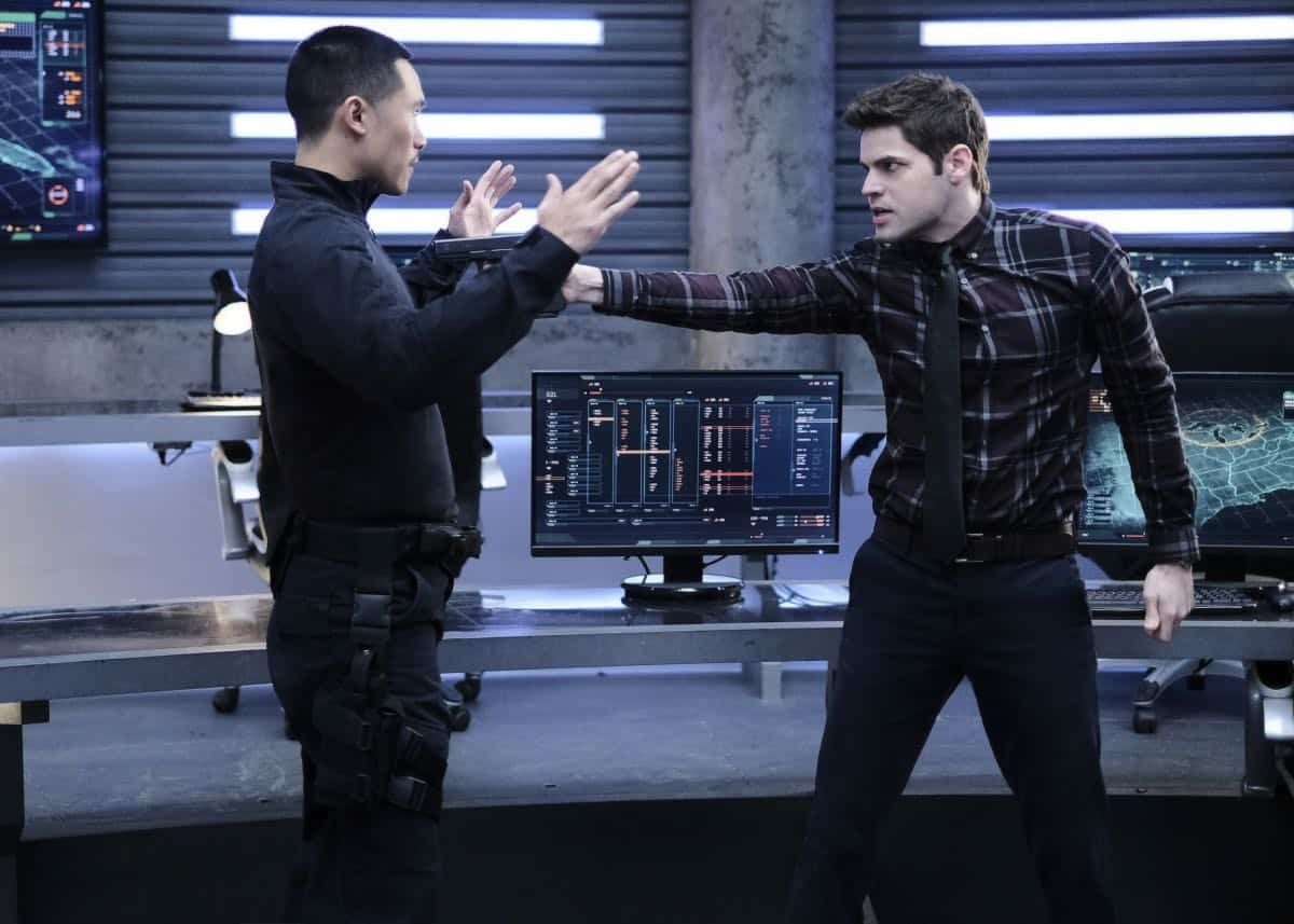 """Supergirl -- """"In Search of Lost Time"""" -- Image Number: SPG315a_0334.jpg -- Pictured (L-R): Curtis Lum as Agent Demos and Jeremy Jordan as Winn -- Photo: Robert Falconer/The CW -- © 2018 The CW Network, LLC. All Rights Reserved."""