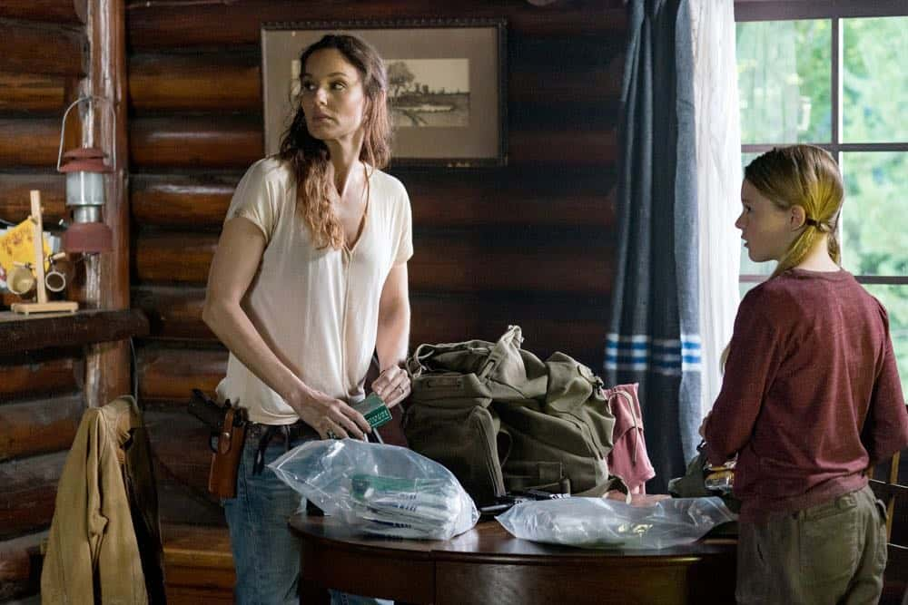 "COLONY -- ""Maquis"" Episode 301 -- Pictured: (l-r) Sarah Wayne Callies as Katie Bowman, Isabella Crovetti-Cramp as Grace Bowman -- (Photo by: Daniel Power/USA Network)"