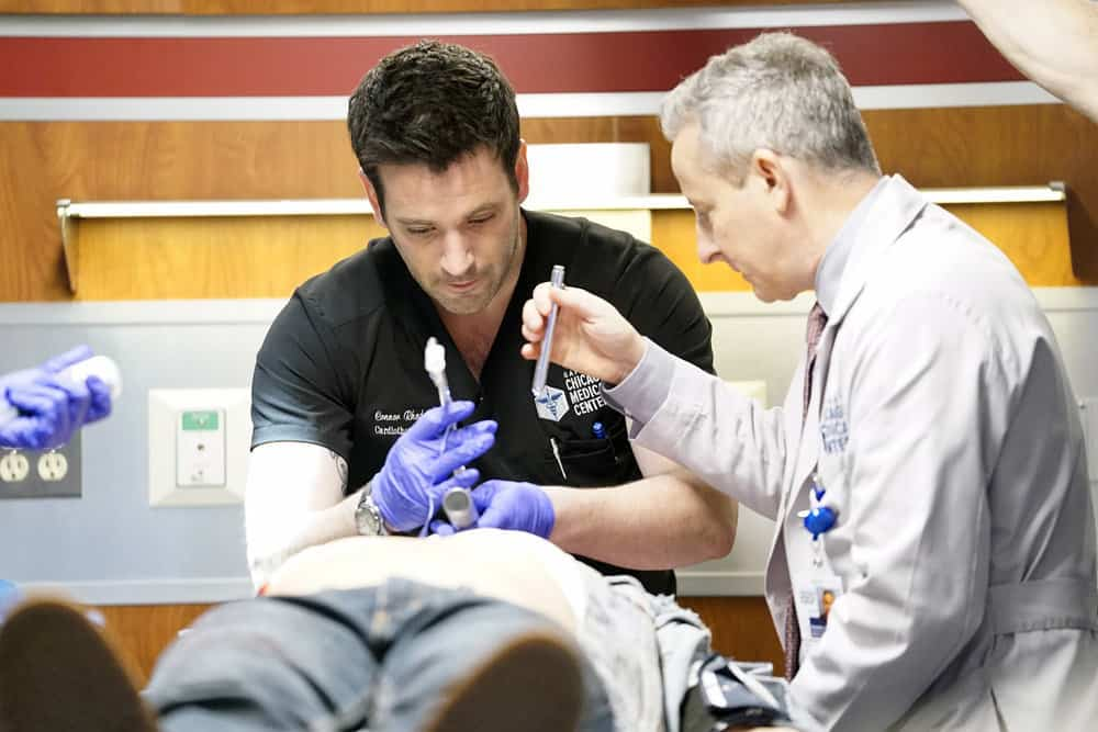 """CHICAGO MED -- """"The Parent Trap"""" Episode 317 -- Pictured: (l-r) Colin Donnell as Connor Rhodes, Eddie Jemison as Dr. Stohl -- (Photo by: Elizabeth Sisson/NBC)"""