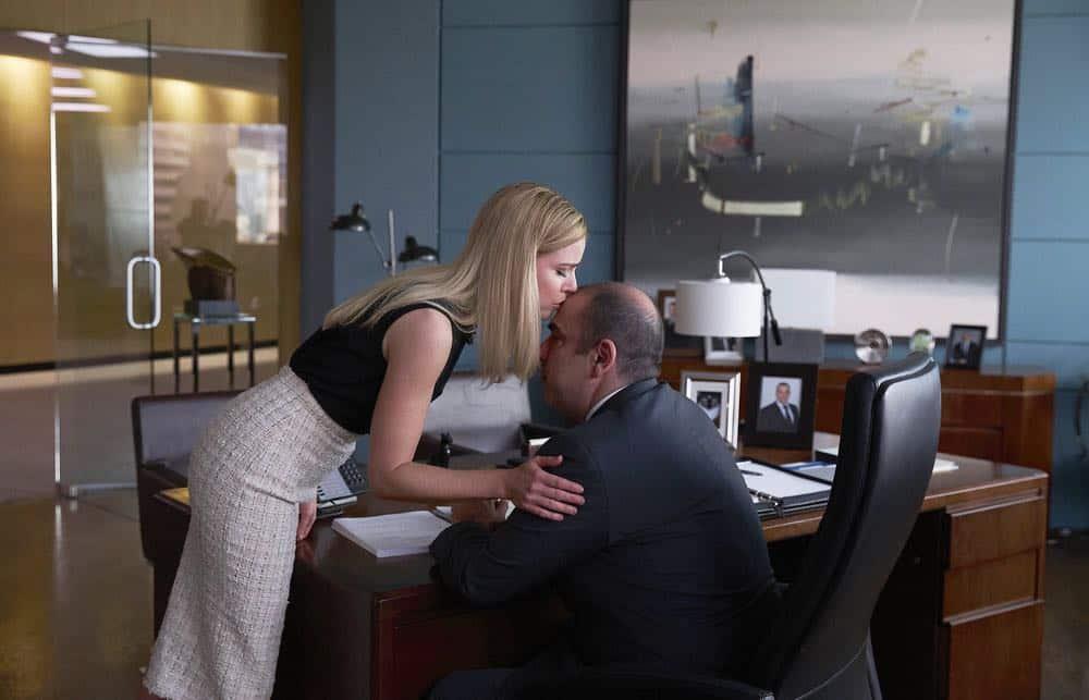 "SUITS -- ""Pulling the Goalie"" Episode 714 -- Pictured: (l-r) Amanda Schull as Katrina Bennett, Rick Hoffman as Louis Litt -- (Photo by: Shane Mahood/USA Network)"