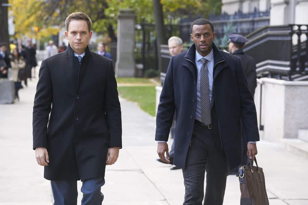 """SUITS -- """"Tiny Violin"""" Episode 715 -- Pictured: (l-r) Patrick J. Adams as Mike Ross, Jordan Johnson-Hinds as Oliver -- (Photo by: Ian Watson/USA Network)"""