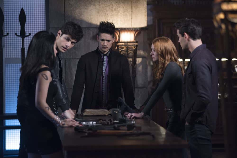 """SHADOWHUNTERS - """"Salt In The Wound"""" - With the Owl's identity revealed, Alec, Isabelle, and Clary head to Alicante to try and find a way to stop him. Luke and Simon team up to track Lilith's  latest possible victim. Maia reflects on her past. This episode of """"Shadowhunters"""" airs Tuesday, May 1 (8:00 - 9:00 p.m. EDT) on Freeform. (Freeform/John Medland) EMERAUDE TOUBIA, MATTHEW DADDARIO, HARRY SHUM JR., KATHERINE MCNAMARA, ALBERTO ROSENDE"""