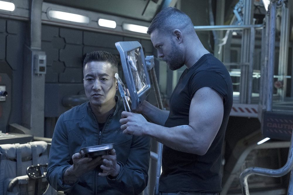 "THE EXPANSE -- ""Assured Destruction"" Episode 303 -- Pictured: (l-r) Terry Chen as Prax, Wes Chatham as Amos Burton -- (Photo by: Rafy/Syfy)"