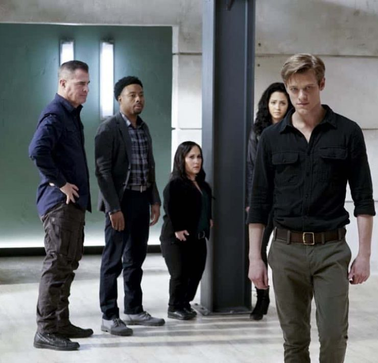 """MacGyver + MacGyver"" -- MacGyver gets a shocking surprise when he tries to tell Matty that he's quitting the Phoenix Foundation, on the second season finale of MACGYVER, Friday, May 4 (8:00-9:00 PM, ET/PT) on the CBS Television Network. Tate Donovan guest stars as Oversight, a man with a history with Matty.Pictured: George Eads, Justin Hires, Meredith Eaton, Tristin Mays, Lucas Till. Photo: Jace Downs/CBS ©2018 CBS Broadcasting, Inc. All Rights Reserved"
