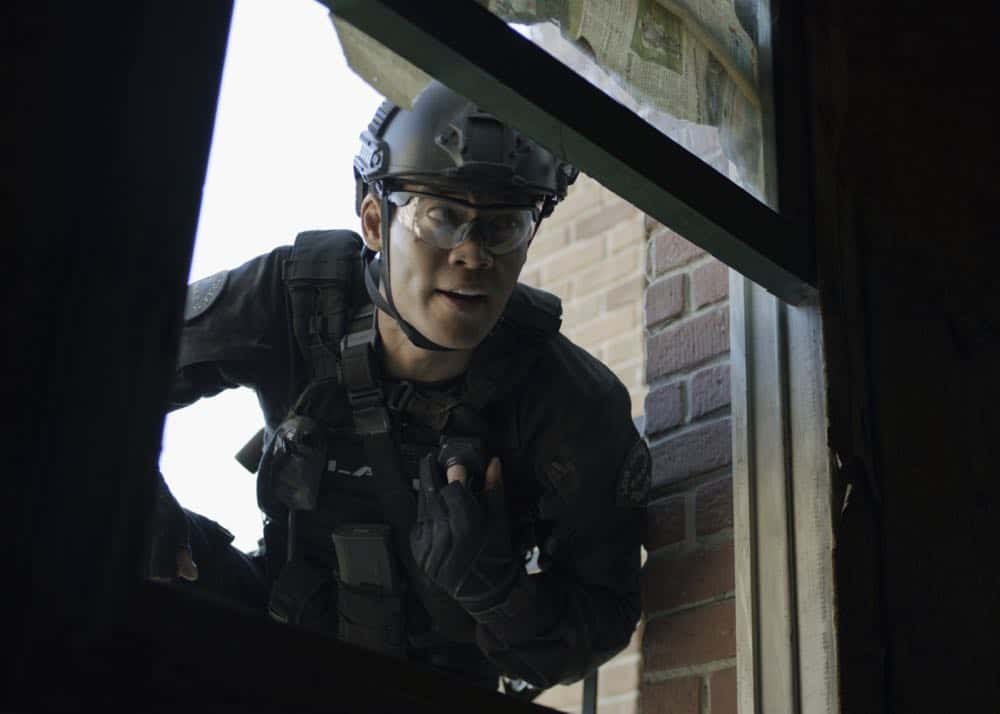 """Shaky Town"" -- The SWAT team engages in a standoff with human traffickers holding child hostages when a major earthquake hits Los Angeles during their operation and compromises the takedown. Also, while Hondo forms an unexpected personal connection with Deputy District Attorney Nia Wells (Nikiva Dionne), Jim Street has trouble adjusting to his new life as a patrol officer, on the second season premiere of S.W.A.T., Thursday, Sept. 27 (10:00-11:00 PM, ET/PT) on the CBS Television Network. Pictured: David Lim as Victor Tan. Photo: Screengrab/CBS ©2018 CBS Broadcasting, Inc. All Rights Reserved"