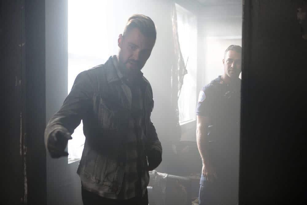 "CHICAGO P.D. -- ""Endings"" Episode 603 -- Pictured: (l-r) Patrick John Flueger as Adam Ruzek, Taylor Kinney as Kelly Severide -- (Photo by: Adrian Burrows/NBC)"
