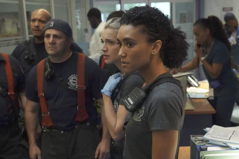 "CHICAGO FIRE -- ""Going to War"" Episode 702 -- Pictured: (l-r) Joe Minoso as Joe Cruz, Tony Ferraris as Tony, Kara Killmer as Sylvie Brett, Annie Ilonzeh as Emily Foster -- (Photo by: Elizabeth Morris/NBC)"