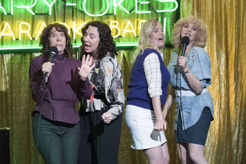 """THE GOLDBERGS - """"RAD!"""" - Erica thinks all of her singing dreams are going to come true when she lands a job at the new karaoke bar in town. But when she's tasked with bringing in more customers, will Erica regret turning to Beverly for help? Meanwhile, Murray tries to teach Barry and Lainey how to be financially responsible adults, on """"The Goldbergs,"""" WEDNESDAY, OCT. 10 (8:00-8:30 p.m. EDT), on The ABC Television Network. (ABC/Ron Tom) MINDY STERLING, STEPHANIE COURTNEY, JENNIFER IRWIN, WENDI MCLENDON-COVEY"""