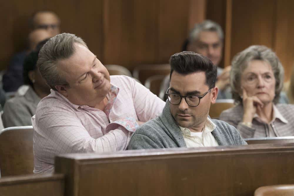 """MODERN FAMILY - """"A Sketchy Area"""" - Phil stumbles into an exciting new career after dropping by Luke's college; while Claire deals with her dad, Jay, and the merger of Pritchett's Closets with a tech-savvy, hipper company. Meanwhile, Mitch's new high-profile case as an assistant district attorney is marred by an unflattering courtroom sketch by the resident artist (Dan Levy), on """"Modern Family,"""" WEDNESDAY, OCT. 10 (9:00-9:31 p.m. EDT), on The ABC Television Network. (ABC/Eric McCandless) ERIC STONESTREET, DAN LEVY"""