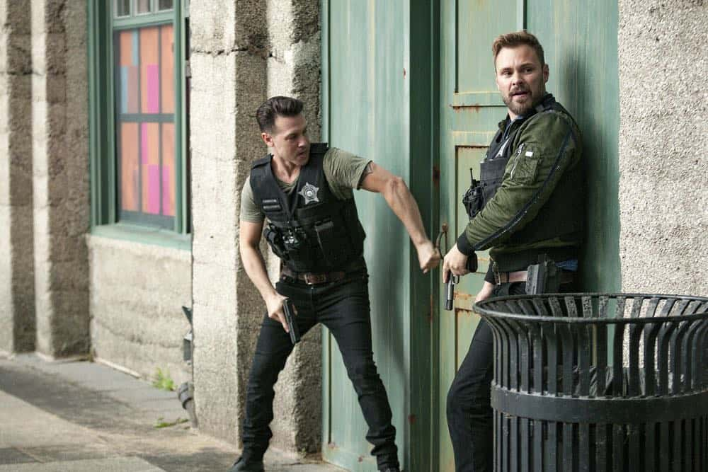 "CHICAGO P.D. -- ""Bad Boys"" Episode 603 -- Pictured: (l-r) Jon Seda as Antonio Dawson, Patrick John Flueger as Adam Ruzek -- (Photo by: Matt Dinerstein/NBC)"