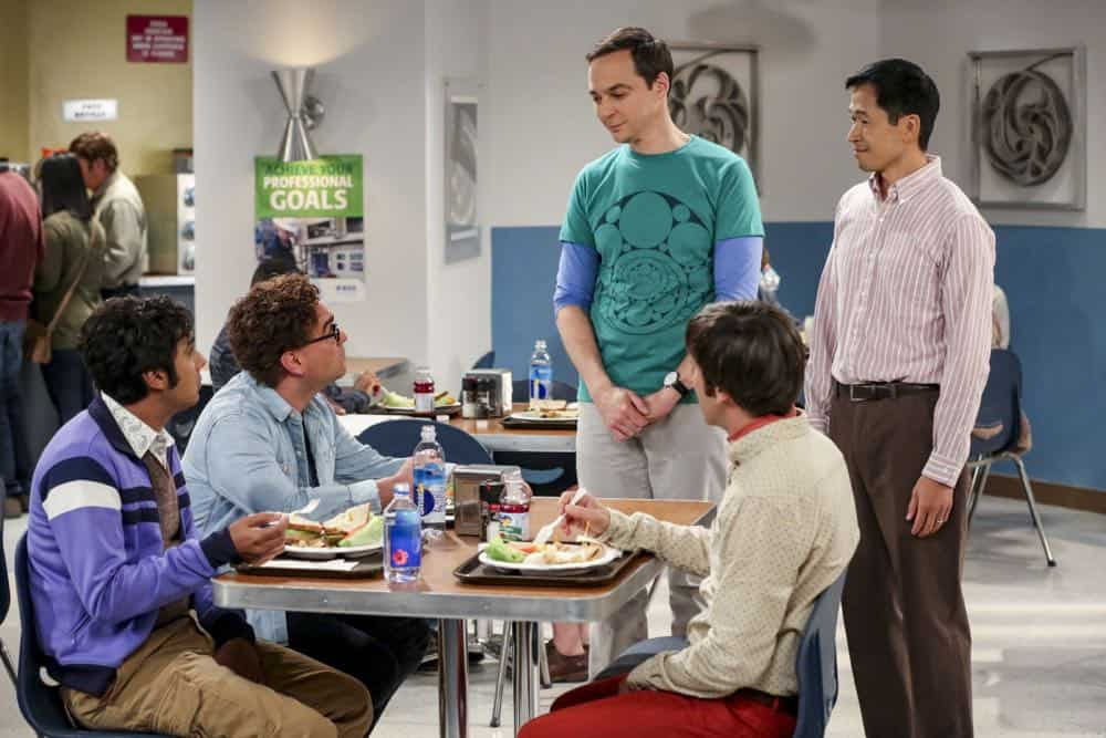 """The Tam Turbulence"" -- Pictured: Rajesh Koothrappali (Kunal Nayyar), Leonard Hofstadter (Johnny Galecki), Sheldon Cooper (Jim Parsons), Howard Wolowitz (Simon Helberg) and Tam (Robert Wu). When Sheldon won't tell anyone why he's never mentioned Tam (Robert Wu), his childhood best friend, Leonard takes matters into his own hands. Also, Bernadette and Penny take out Raj's fiancée, Anu (Rati Gupta), for dinner to get the skinny on her, on THE BIG BANG THEORY, Thursday, Oct. 11 (8:00-8:31 PM, ET/PT) on the CBS Television Network. Jerry O'Connell returns as Sheldon's brother, George. Photo: Michael Yarish/CBS ©2018 CBS Broadcasting, Inc. All Rights Reserved."