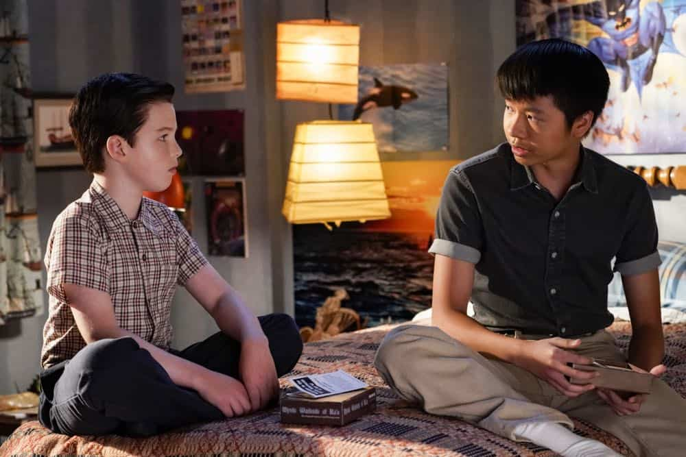 """A Financial Secret and Fish Sauce"" - Pictured: Sheldon (Iain Armitage) and Tam (Ryan Phuong). When George Sr. asks Sheldon to keep a secret from Mary, the stress of not being honest drives Sheldon to hideout at Tam's for his first sleepover, on YOUNG SHELDON, Thursday, Oct. 11 (8:31-9:01 PM, ET/PT) on the CBS Television Network. Photo: Robert Voets/Warner Bros. Entertainment Inc. © 2018 WBEI. All rights reserved."