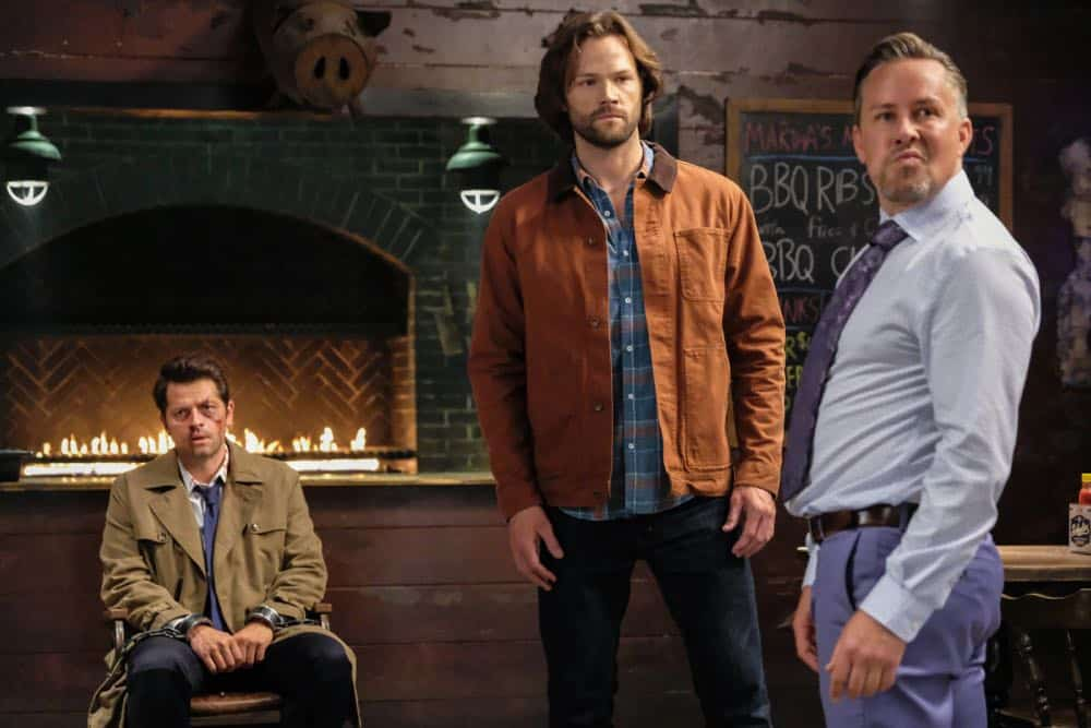 "Supernatural -- ""Stranger in a Strange Land"" -- Image Number: SN1401b_0051b.jpg -- Pictured (L-R): Misha Collins as Castiel, Jared Padalecki as Sam and Dean Armstrong as Kip -- Photo: Bettina Strauss/The CW -- © 2018 The CW Network, LLC All Rights Reserved"