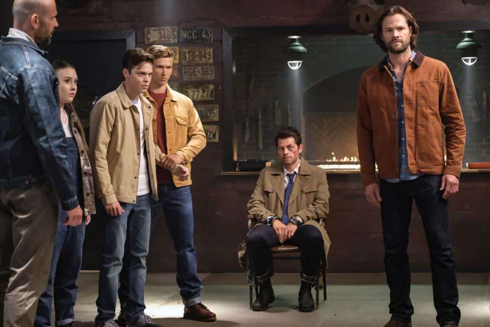 "Supernatural -- ""Stranger in a Strange Land"" -- Image Number: SN1401b_0091b.jpg -- Pictured (L-R): Katherine Evans as Maggie, Alexander Calvert as Jack, Misha Collins as Castiel and Jared Padalecki as Sam -- Photo: Bettina Strauss/The CW -- © 2018 The CW Network, LLC All Rights Reserved"