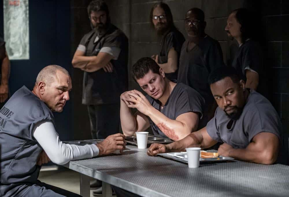 "Arrow -- ""Inmate #4587"" -- Image Number: AR701b_0073b -- Pictured (L-R): Vinnie Jones as Danny ""Brick"" Brickwell, Cody Runnels as Derek Sampson and Michael Jai White as Ben Turner/Bronze Tiger -- Photo: Jack Rowand/The CW -- © 2018 The CW Network, LLC. All Rights Reserved."