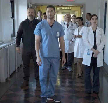 """NEW AMSTERDAM -- """"Boundaries"""" Episode 104 -- Pictured: (l-r) Tyler Labine as Dr. Iggy Frome, Ryan Eggold as Dr. Max Goodwin, Anupam Kher as Dr. Vijay Kapoor, Freema Agyeman as Dr. Helen Sharpe, Janet Montgomery as Dr. Lauren Bloom -- (Photo by: Francisco Roman/NBC)"""