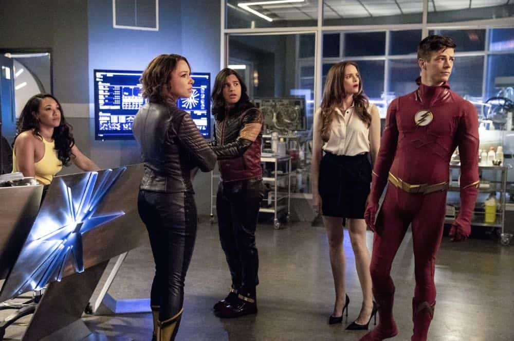 "The Flash -- ""Blocked"" -- Image Number: FLA502a_0151b.jpg -- Pictured (L-R): Candice Patton as Iris West - Allen, Jessica Parker Kennedy as Nora West -Allen/XS, Carlos Valdes as Cisco Ramon/Vibe, Danielle Panabaker as Caitlin Snow and Grant Gustin as Barry Allen/ The Flash -- Photo: Jack Rowand/The CW -- © 2018 The CW Network, LLC. All rights reserved"