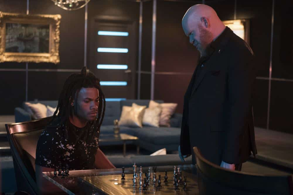 "Black Lightning -- ""The Book Of Consequences: Chapter Two: Black Jesus Blues"" -- Image BLK202c_0153b.jpg -- Pictured (L-R): Jordan Calloway as Khalil/Painkiller and Marvin ""Krondon"" Jones III as Tobias -- Photo: Annette Brown/The CW -- © 2018 The CW Network, LLC. All rights reserved"