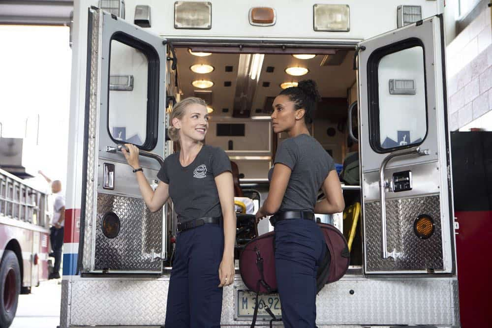 """CHICAGO FIRE -- """"This Isn't Charity"""" Episode 704 -- Pictured: (l-r) Kara Killmer as Sylvie Brett, Annie Ilonzeh as Emily Foster -- (Photo by: Adrian Burrows/NBC)"""