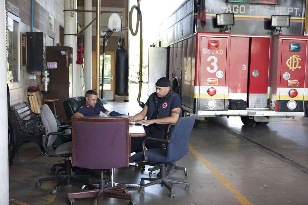 """CHICAGO FIRE -- """"This Isn't Charity"""" Episode 704 -- Pictured: (l-r) Taylor Kinney as Kelly Severide, Joe Minoso as Joe Cruz -- (Photo by: Adrian Burrows/NBC)"""