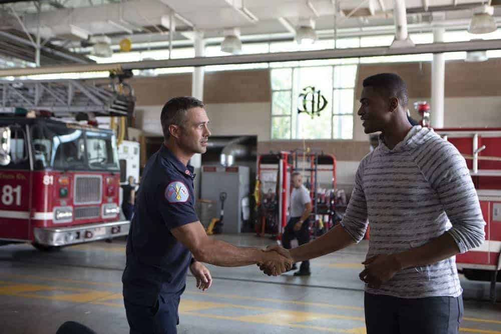 """CHICAGO FIRE -- """"This Isn't Charity"""" Episode 704 -- Pictured: (l-r) Taylor Kinney as Kelly Severide, Justin Cornwell as Tyler -- (Photo by: Adrian Burrows/NBC)"""