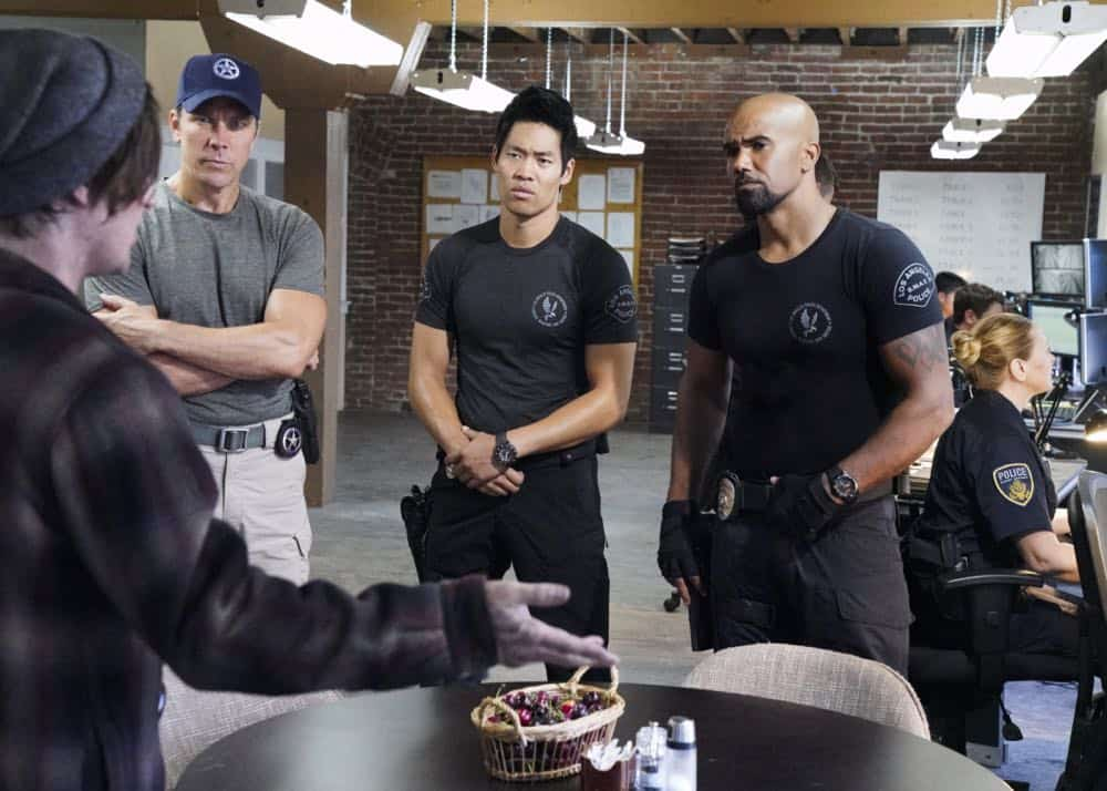 """Saving Face"" -- Hondo suspects ulterior motive when the estranged U.S. Marshal husband (Michael Trucco) of his romantic interest, Deputy District Attorney Nia Wells (Nikiva Dionne), requests the S.W.A.T. team's help with the apprehension of a fugitive robbing drug cargo shipments. Also, Jessica is forced to implement departmental budget cuts as Street makes a heartbreaking discovery about his mother Karen (Sherilyn Fenn) on, on S.W.A.T., Thursday, Oct. 18 (10:00-11:00 PM, ET/PT) on the CBS Television Network. Pictured L to R: David Lim as Victor Tan and Shemar Moore as Daniel ""Hondo"" Harrelson. Photo: Bill Inoshita/CBS ©2018 CBS Broadcasting, Inc. All Rights Reserved"