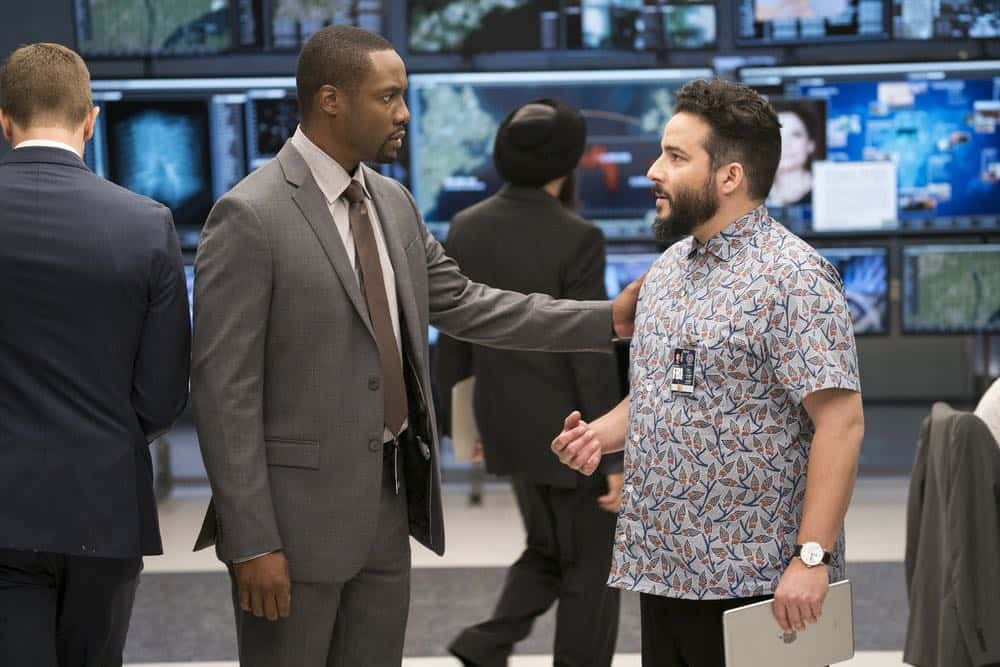 "BLINDSPOT -- ""My Art Project"" Episode 402 -- Pictured: (l-r) Rob Brown as Edgar Reade, Ennis Esmer as Rich Dotcom -- (Photo by: Scott Gries/NBC/Warner Bros.)"