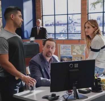 """""""Fragments"""" After a 50-year-old tape recording left by a murder victim is found, the NCIS team tries to exonerate Ray Jennings (Charlie Robinson), the Marine serving a life sentence for the crime, on NCIS, Tuesday, Oct. 23 (8:00-9:00 PM, ET/PT) on the CBS Television Network. Pictured: Wilmer Valderrama, Sean Murray, Emily Wickersham. Photo: Greg Gayne/CBS ©2018 CBS Broadcasting, Inc. All Rights Reserved"""